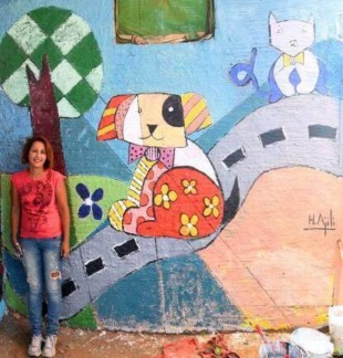 Hoda al Ajili from Tunisia with her children world wall  work
