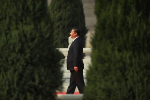 Chinese President Xi Jinping walks toward the Monument to the People's Heroes during a ceremony marking Martyrs' Day at Tiananmen Square in Beijing Friday, Sept. 30, 2016. Xi and other Chinese leaders presented flower baskets and scores of ordinary people filed up to lay a single flower each on Friday at the monument to mark Martyrs' Day. (AP Photo/Mark Schiefelbein)
