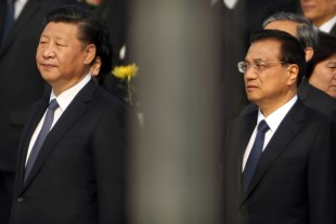 Chinese President Xi Jinping, left, and Premier Li Keqiang, right, stand during a ceremony marking Martyrs' Day at Tiananmen Square in Beijing Friday, Sept. 30, 2016. Xi and other Chinese leaders presented flower baskets and scores of ordinary people filed up to lay a single flower each on Friday at the Monument to the People's Heroes to mark Martyrs' Day. (AP Photo/Mark Schiefelbein)