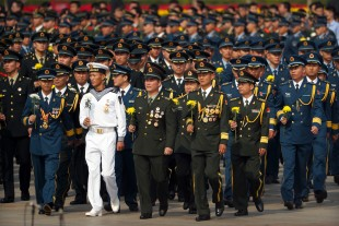 Members of China's People's Liberation Army (PLA) walk to pay respects during a ceremony marking Martyrs' Day at Tiananmen Square in Beijing Friday, Sept. 30, 2016. Chinese President Xi Jinping and other Chinese leaders presented flower baskets and scores of ordinary people filed up to lay a single flower each on Friday at the Monument to the People's Heroes to mark Martyrs' Day. (AP Photo/Mark Schiefelbein)