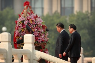 Chinese President Xi Jinping and Premier Li Keqiang, right, walk up the steps of the Monument to the People's Heroes during a ceremony commemorating Martyrs' Day at Tiananmen Square in Beijing Friday, Sept. 30, 2016. Xi and other Chinese leaders presented flower baskets and scores of ordinary people filed up to lay a single flower each on Friday at the monument to mark Martyrs' Day. (AP Photo/Mark Schiefelbein)