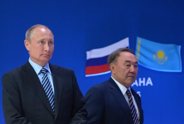 Kazakstan's President Nursultan Nazarbayev, right, and Russian President Vladimir Putin walk to participate in a business forum in Astana, Kazakhstan on Tuesday, Oct. 4, 2016. (Alexei Druzhinin/Sputnik, Kremlin Pool Photo via AP)