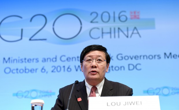 (161007) -- WASHINGTON D.C., Oct. 7, 2016 (Xinhua) -- Chinese Finance Minister Lou Jiwei speaks at a press conference on G20 Finance Ministers and Central Bank Governors Meeting at the headquarters of International Monetary Fund(IMF) in Washington D.C., the United States, Oct. 7, 2016. Global economy continued to face uncertainty and rising risks, Lou Jiwei said on behalf of the G20 economies on Friday. (Xinhua/Yin Bogu)