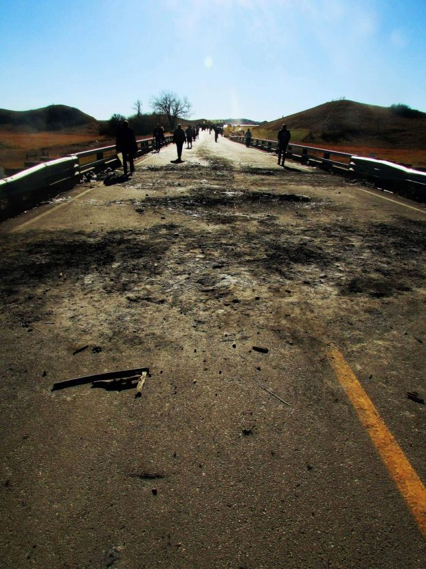 [Burnt Bridge Between the Camp and the Construction Site - Muriel Kennedy]