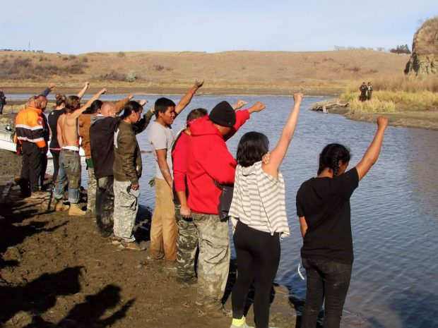 [Water Protectors Raise Their Arms in Solidarity - Muriel Kennedy]