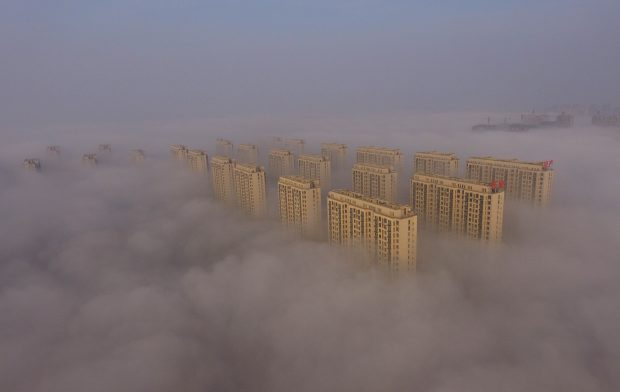 RIZHAO, Nov. 14, 2016 (Xinhua) -- Photo taken on Nov. 14, 2016 shows buildings shrouded in fog in Rizhao, east China's Shandong Province. The National Meteorological Center (NMC) issued an orange warning for heavy fog in east and central China on Monday. (Xinhua/Liu Mingzhao)(wyo)