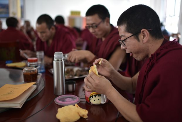Nov. 17, 2016 (Xinhua) -- Monks have a meal at Qinghai Tibetan Buddhism College in Guide County, northwest China's Qinghai Province, Nov. 16, 2016. The first batch of 120 monks have started their four-year full-time study at the newly-opened Tibetan Buddhism college recently. (Xinhua/Zhang Hongxiang)(mcg)
