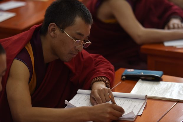 Nov. 17, 2016 (Xinhua) -- A monk takes notes during a lesson at Qinghai Tibetan Buddhism College in Guide County, northwest China's Qinghai Province, Nov. 16, 2016. The first batch of 120 monks have started their four-year full-time study at the newly-opened Tibetan Buddhism college recently. (Xinhua/Zhang Hongxiang)(mcg)