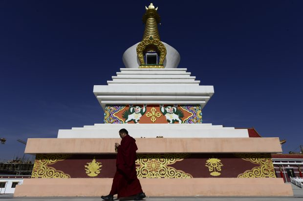 Nov. 17, 2016 (Xinhua) -- A monk is seen at Qinghai Tibetan Buddhism College in Guide County, northwest China's Qinghai Province, Nov. 16, 2016. The first batch of 120 monks have started their four-year full-time study at the newly-opened Tibetan Buddhism college recently. (Xinhua/Zhang Hongxiang)(mcg)