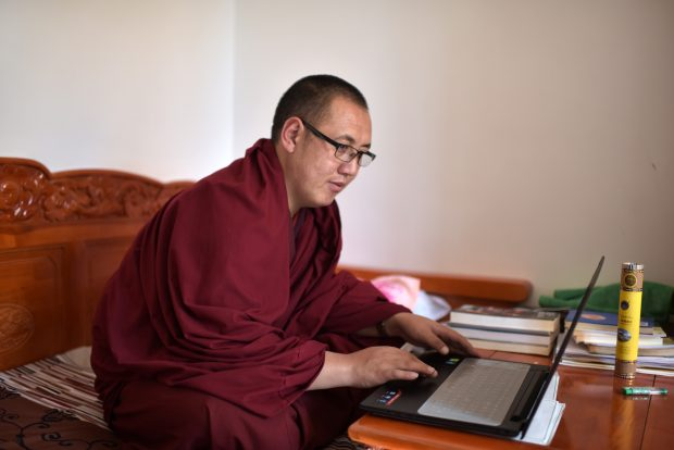 Nov. 17, 2016 (Xinhua) -- A monk learns sutra in his dormitory at Qinghai Tibetan Buddhism College in Guide County, northwest China's Qinghai Province, Nov. 16, 2016. The first batch of 120 monks have started their four-year full-time study at the newly-opened Tibetan Buddhism college recently. (Xinhua/Zhang Hongxiang)(mcg)
