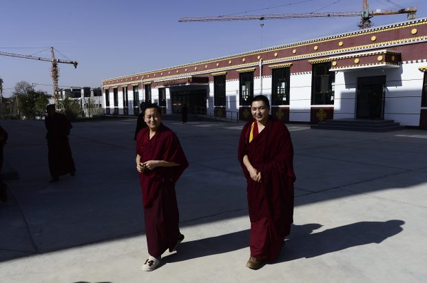 Nov. 17, 2016 (Xinhua) -- Monks walk past a dining hall at Qinghai Tibetan Buddhism College in Guide County, northwest China's Qinghai Province, Nov. 16, 2016. The first batch of 120 monks have started their four-year full-time study at the newly-opened Tibetan Buddhism college recently. (Xinhua/Zhang Hongxiang)(mcg)