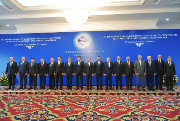 Heads of government from China, Kazakhstan, Kyrgyzstan, Russia, Tajikistan, and Uzbekistan and delegation members pose during a photo session in Bishkek, Kyrgyzstan, Thursday, Nov. 3, 2016. Heads of government from countries of the Shanghai Cooperation Organisation, a group dominated by Russia and China and also including former Soviet republics in Central Asia, gather in the Kyrgyz capital for a summit. (Alexander Astafyev/Sputnik, Government Press Service, Pool Photo via AP)