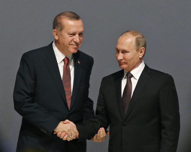 In this Oct. 10, 2016 file photo, Turkey's President Recep Tayyip Erdogan, left and Russian President Vladimir Putin, shake hands following the group photo at the World Energy Congress, in Istanbul, Turkey. With his victory in Aleppo, Syrian President Bashar Assad appears to have survived a nearly six-year war to drive him from power, but he is now more dependent on outside powers than ever. His key allies Russia and Iran, along with Turkey, are best placed to determine Syria's endgame, which could more closely resemble a grand bargain among great powers than a political settlement among Syrians themselves. (AP Photo/Emrah Gurel, File)