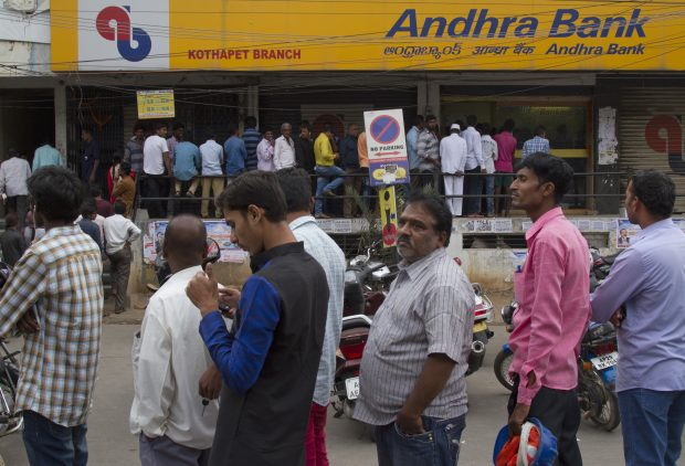 Indians stand in a queue outside an ATM to withdraw money in Hyderabad, India, Friday, Dec. 2, 2016. Indian Prime Minister Narendra Modi, in his Nov. 8 televised address, announced demonetization of India's 500 and 1,000-rupee notes, which made up 86 percent of the country's currency. People have been forced to stand in long queues to change banned notes and also to take out new currency from their accounts after severe limitations were imposed on withdrawal from banks and ATMs. (AP Photo/Mahesh Kumar A.)