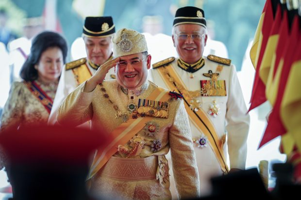 Sultan Muhammad V, center, greets after his welcoming ceremony as he walks with Malaysian Prime Minister Najib Razak, right, to Parliament in Kuala Lumpur, Malaysia on Tuesday, December 13, 2016. Sultan Muhammad V of Kelantan will serve five one-year terms as King of Malaysia starting Tuesday.  (AP Photo / Vincent Thian)