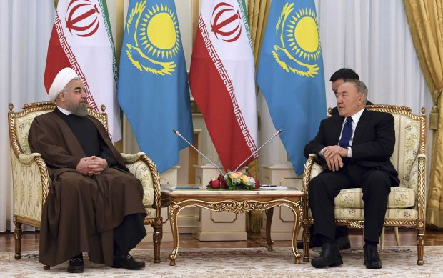 Kazakhstan's President Nursultan Nazarbayev, right, meets with President of the Islamic Republic of Iran Hassan Ruhani in Astana, Kazakhstan on Thursday, Dec. 22, 2016. (Presidential Press Service via AP)