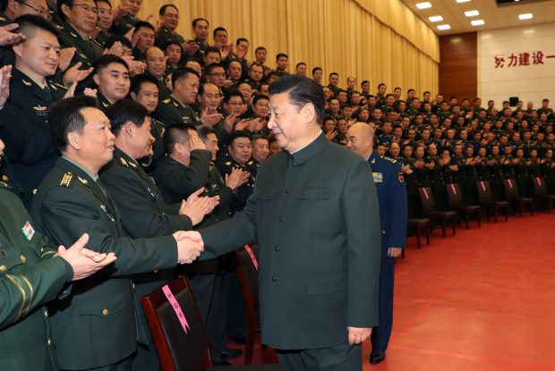 ZHANGJIAKOU, Jan. 25, 2017 (Xinhua) -- Chinese President Xi Jinping (R, front), also general secretary of the Communist Party of China (CPC) Central Committee and chairman of the Central Military Commission, shakes hands with senior military officers stationed in Zhangjiakou City, north China's Hebei Province, Jan. 23, 2017. Xi visited the 65th Army Group stationed in northern China's Hebei Province on Monday. (Xinhua/Li Gang) (zyd)