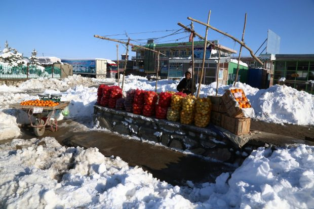 (170206) -- GHAZNI, Feb. 6, 2017 (Xinhua) -- An Afghan vendor waits for costumers after a heavy snow in eastern Ghazni province, Afghanistan, Feb. 6, 2017. At least 100 people have lost their lives and more than 50 others sustained injuries due to snowfall and freezing weather over the past few days across Afghanistan, local media reported. (Xinhua/Sayed Mominzadah)(gl)