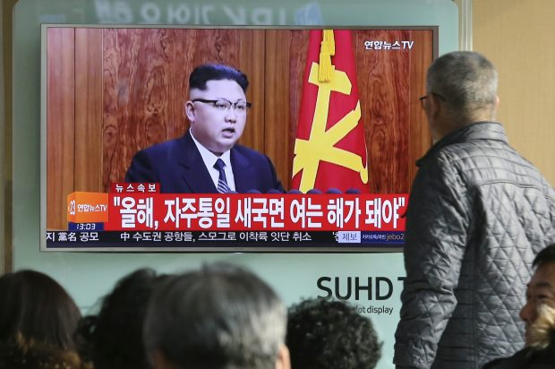 "FILE - In this Sunday, Jan. 1, 2017 file photo, South Koreans watch a TV news program showing North Korean leader Kim Jong Un's New Year's speech, at the Seoul Railway Station in Seoul, South Korea. North Korea reportedly fired a ballistic missile early Sunday, Feb.  12, 2017, in what would be its first such test of the year and an implicit challenge to President Donald Trump's new administration. Details of the launch, including the type of missile, were scant. The letters on the screen read ""New Year for Reunification."" (AP Photo/Ahn Young-joon, File)"