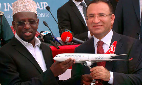 Turkey's deputy prime minister, Bekir Bozdag, right, with Somalia's president, Sheikh Sharif Sheikh Ahmed, after the maiden flight from Istanbul to Mogadishu. Photograph: Mohamed Abdiwahab