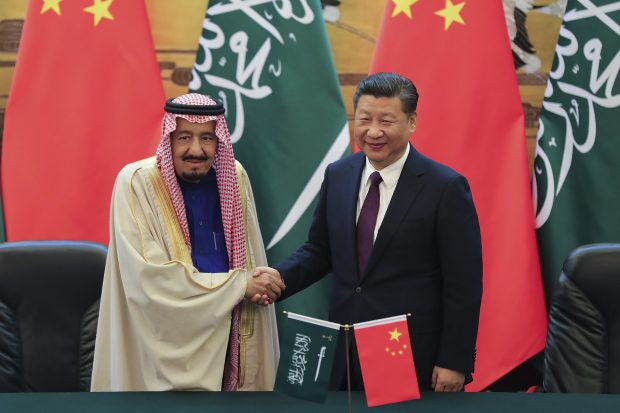 Chinese President Xi Jinping, right, and Saudi King Salman pose for photographers during a signing ceremony at the Great Hall of the People in Beijing, China, Thursday, March 16, 2017. (Lintao Zhang/Pool Photo via AP)