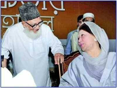 Former prime minister Khaleda Zia was seen talking to Ghulam Azam, who was chief of the anti-liberation Jamaat-e-Sialmi and was considered as a symbol of war criminals. Khaleda's BNP forged electoral alliance with Jamaat around one and a half decade ago. Ghulam Azam was also convicted for war crimes and died in jail.