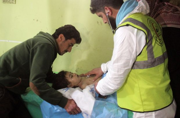 An unconscious Syrian child receives treatment at a hospital in Khan Sheikhun, a rebel-held town in the northwestern Syrian Idlib province, following a suspected toxic gas attack on April 4, 2017. A suspected chemical attack killed at least 58 civilians including several children in rebel-held northwestern Syria, a monitor said, with the opposition accusing the government and demanding a UN investigation. / AFP PHOTO / Omar haj kadour