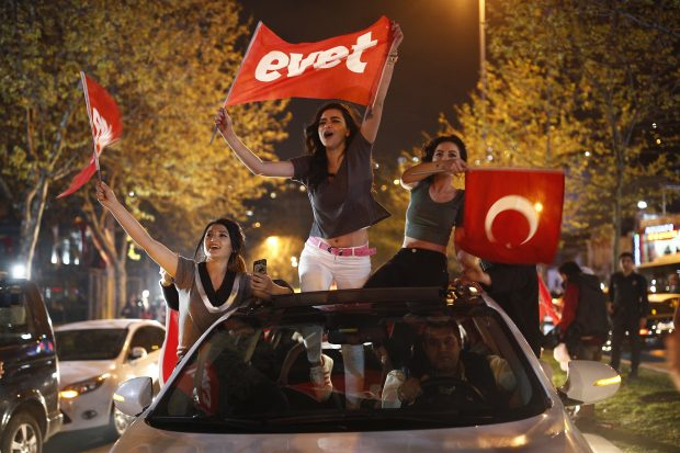 "Supporters of the ""Yes"" vote, wave flags during celebrations in Istanbul, on Sunday, April 16, 2017.(AP Photo/Newsis)"