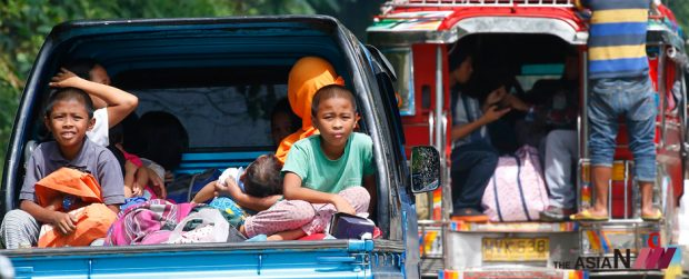 Residents flee Marawi City under attack by Muslim militants.
