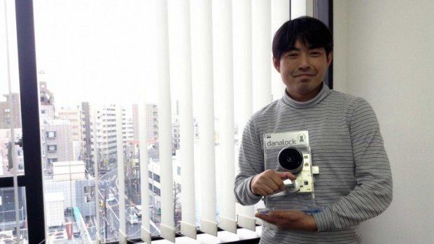 Z-Works CEO, Makoto Ogawa with the door-knob sensor