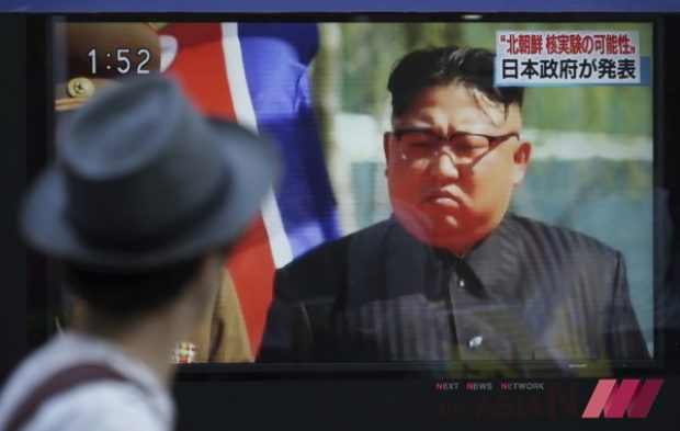 A man watches a TV news program on a public screen showing an image of North Korean leader Kim Jong Un while reporting North Korea's possible nuclear test in Tokyo Sunday, Sept. 3, 2017. South Korea's military said Sunday that North Korea is believed to have conducted its sixth nuclear test after it detected a strong earthquake, hours after Pyongyang claimed that its leader has inspected a hydrogen bomb meant for a new intercontinental ballistic missile. (Photo : AP /NEWSis)
