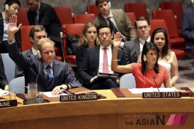 In this Aug. 5, 2017, photo, British Ambassador to the United Nations Matthew Rycroft, left, and U.S. Ambassador to the United Nations Nikki Haley vote during a Security Council meeting on a new sanctions resolution that would increase economic pressure on North Korea to return to negotiations on its missile program at U.N. headquarters. The strongest U.N. sanctions in a generation may still prove no match for North Korea's relentless nuclear weapons ambitions. Even in diplomatic triumph, the Trump administration is gambling that it has enough time to test if economic pressure can get Kim Jong Un's totalitarian government to end its missile advances and atomic weapons tests (Photo : AP /NEWSis)