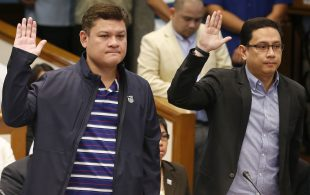 "Paolo Duterte, left, the eldest son of President Rodrigo Duterte and the President's son-in-law Manases Carpio, a lawyer, take their oaths in the continuing senate probe on the more than half a ton of the illegal drug methamphetamine hydrochloride, locally known as ""Shabu"" worth $128 million (P6.4 Billion Pesos) from China which passed through customs from China Thursday, Sept. 7, 2017, in Pasay city, southeast of Manila, Philippines."
