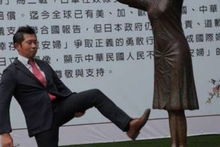 A Japanese right-winger kicks the symbolic statue of the victims of Japan's wartime sexual slavery in Taipei, Thursday. Screen grab from the United Daily News.