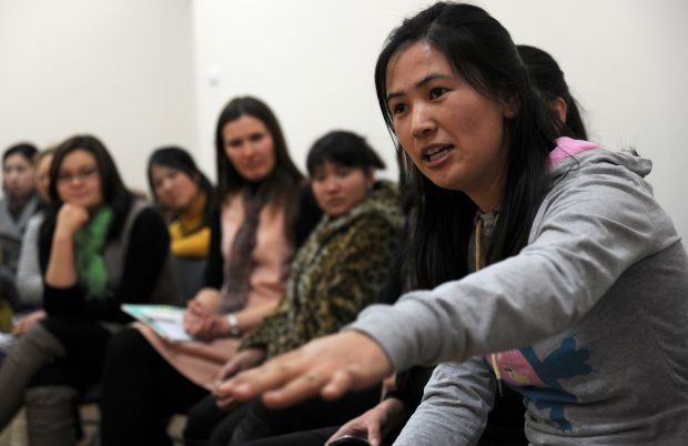 Venera Myrzabaeva, a 22-year-old Kyrgyz Republic university student, explains the cultural pressure on Kyrgyz women to marry by the age of 25 to female Airmen from the Transit Center at Manas during the Women's Club discussion at the American Corner in Bishkek, Kyrgyzstan, Feb. 17, 2012. More than 30 female students and faculty members attended this week's cultural exchange. Topics discussed included marriage, children, career goals and life regrets. Venera is studying linguistics at the university. (U.S. Air Force photo/Master Sgt. Tracy L. DeMarco)