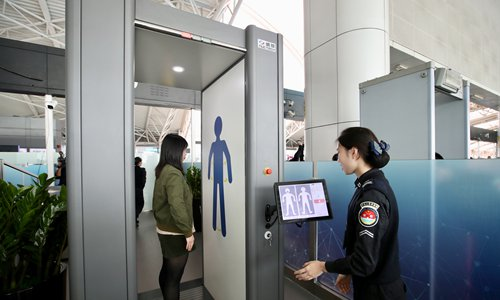 A female passenger goes through security check at Guangzhou Baiyun International Airport in South China's Guangdong Province on January 25.