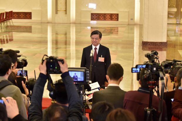 Ni Yuefeng, head of the General Administration of Customs of China, receives interview. (Photo from People's Daily Online)