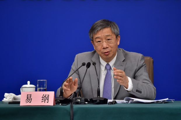 Yi Gang, governor of the People's Bank of China answers questions from journalists at a press conference on the sidelines of the two sessions in Beijing on Sunday, March 10. (Photo by Weng Qiyu from People's Daily Online)