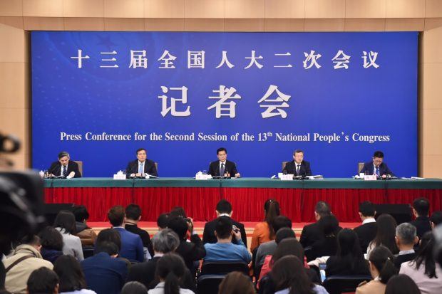 Officials with China's Ministry of Commerce attend a press conference on China's domestic market and all-round opening-up for the second session of the 13th National People's Congress (NPC) in Beijing, March 9, 2019. (Photo from People's Daily Online)