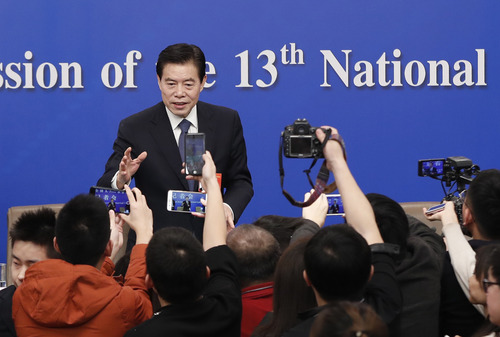 China's Minister of Commerce Zhong Shan answers questions at a press conference on China's domestic market and all-round opening-up for the second session of the 13th National People's Congress (NPC), March 9, 2019. (Photo: 'CFP)