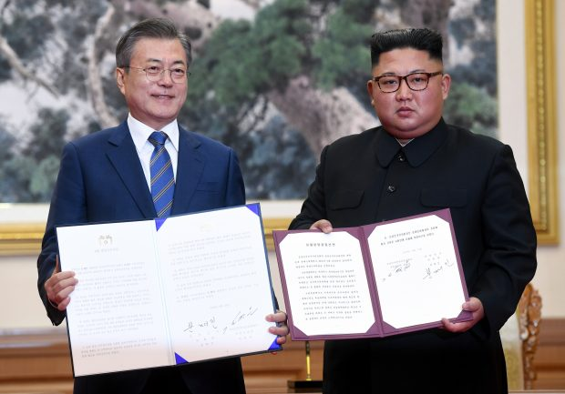 FILE - In this Sept. 19, 2018 photo, South Korean President Moon Jae-in, left, and North Korean leader Kim Jong Un hold the documents after signing at the Paekhwawon State Guesthouse in Pyongyang, North Korea. Kim Jong Un is preparing for his second summit with President Donald Trump in two weeks in Vietnam that doesn't include South Korean President Moon Jae-in. (Pyongyang Press Corps Pool via AP, File)/2019-02-14 01:01:09/