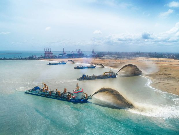 Four large trailing suction hopper dredgers reclaim land for the Colombo Port City near the Colombo Harbor in Sri Lanka, a key project for China and Sri Lanka to jointly build the Maritime Silk Road. The project is jointly developed by the government of Sri Lanka and China Harbour Engineering Company Limited under the Belt and Road Initiative. Both sides aim to build a high-end urban complex that gathers finance, tourism, logistics and information technology services via land reclamation. (Photo provided by China Harbour Engineering Company Limited)
