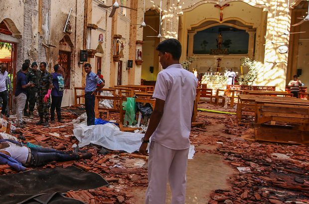 Sri Lankan soldiers look on inside the St Sebastian's Church at Negombo on April 21, 2019, following a bomb blast during the Easter service that killed worshippers. A series of eight devastating bomb blasts ripped through high-end hotels and churches holding Easter services in Sri Lanka on April 21, killing nearly  200 people, including dozens of foreigners.      Photo by Perera Sameera/UPI/2019-04-22 03:57:18/