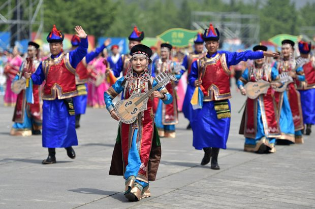 Actors and actresses perform during the Asian Civilization Parade, May 16, 2019. Costumed performers from 16 countries and 28 domestic performance teams presented festive songs and dances to showcase the distinctive charm of Asian civilizations. (Photo by Weng Qiyu/People's Daily Online)