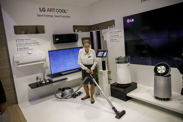 epa06177116 A hostess cleans the floor with a newly developed vacuum cleaner of the company LG the Internationale Funkaustellung Berlin (IFA), an international consumer electronics fair, in Berlin, Germany, 01 September 2017. The IFA is the world's leading trade show for consumer electronics and home appliances and is open for the general public from 01 to 06 September. The fair presents over 1800 exhibitors from more than 50 countries and is expected to be visited by more than 200.000 visitors this year.  EPA/CARSTEN KOALL/2017-09-02 00:11:40/