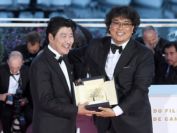 Song Kang-ho(L) and the director Bong Jun'ho at the 72nd Cannes Film Festival.
