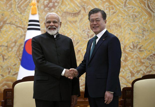 Indian Prime Minister Narendra Modi, left, shakes hands with South Korea's President Moon Jae-in during their meeting at the presidential Blue House in Seoul Friday, Feb. 22, 2019. Modi is on a two-day visit to South Korea as part of an effort to strengthen ties between the two countries. (Jung Yeon-je/Pool Photo via AP)