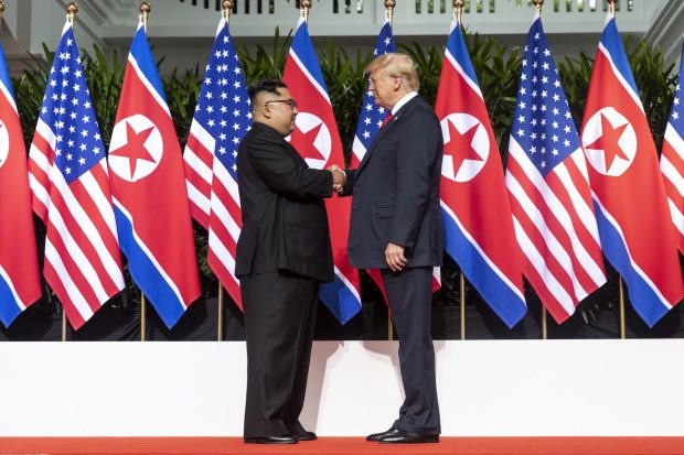 kim_and_trump_shaking_hands_at_the_red_carpet_during_the_dprk-usa_singapore_summit