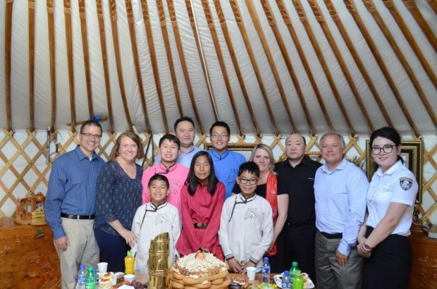 The children and their US families during the visit – MONTSAME
