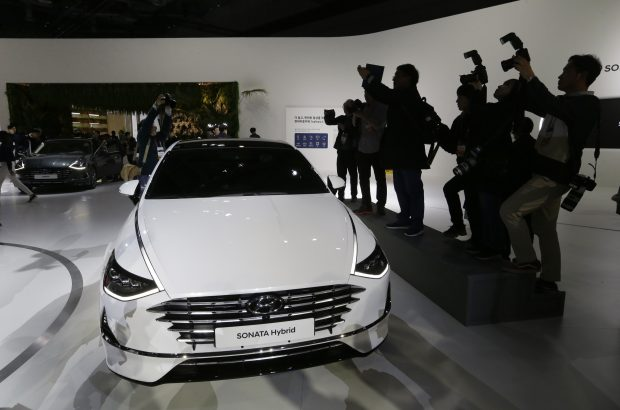 Hyundai Motor's Sonata Hybrid is displayed during a media preview of the Seoul Motor Show in Goyang, South Korea, Thursday, March 28, 2019. The exhibition will be held from March 29 to April 7 with 20 brands showing their latest cars and concepts. (AP Photo/Ahn Young-joon)